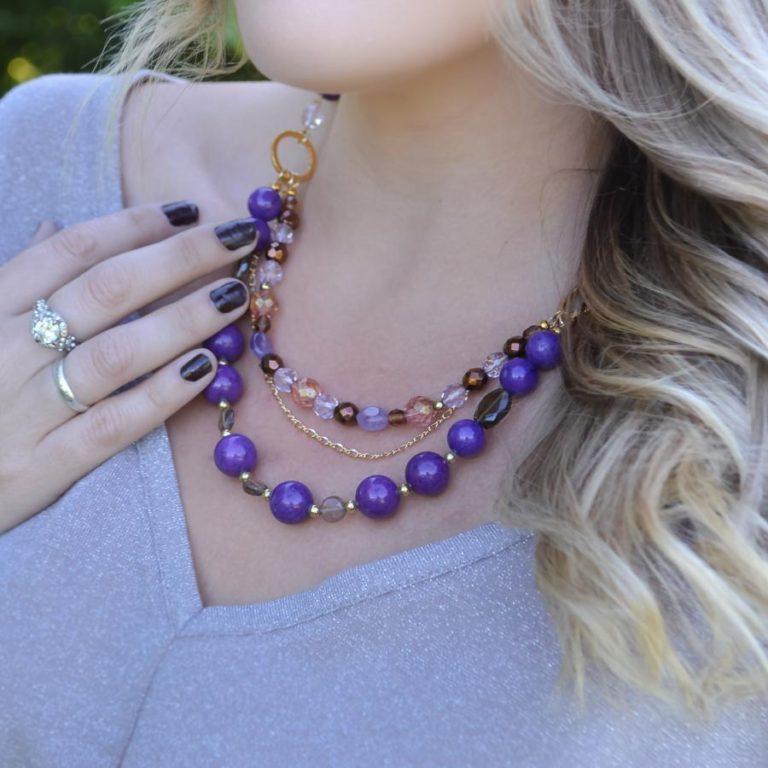woman wearing purple necklace