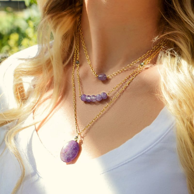 woman wearing amethyst necklace stack
